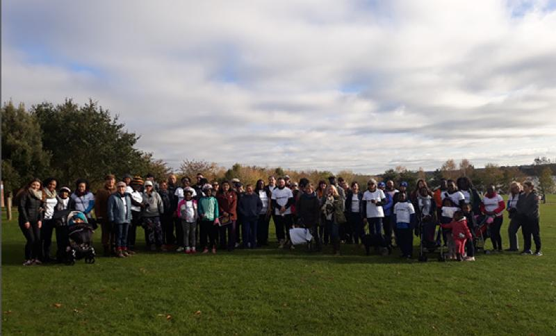 Group picture of staff and their families who took part in the walk for Windrush on 27 October.