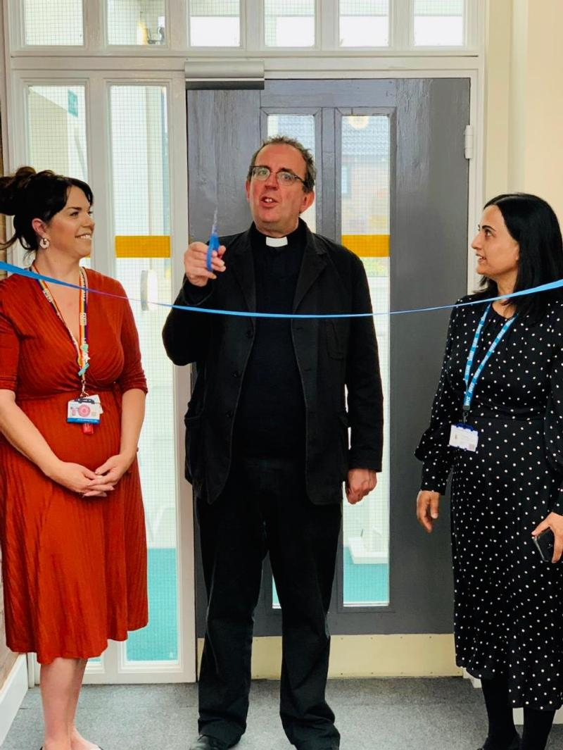 Reverend Richard Coles cuts the ribbon of the Rushden Resource Centre
