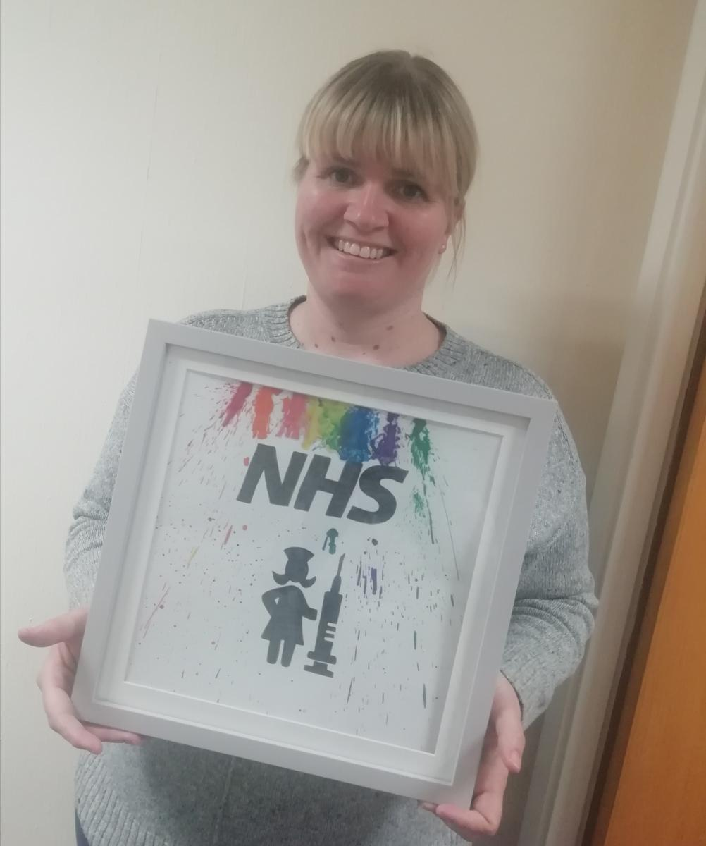 Michelle, a Children's Community Nurse with a drawing gifted to her by one of the families she cares for