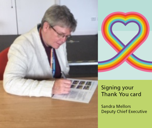 Sandra Mellors Deputy Chief Executive signing the staff thank you cards inside at Berrywood Hospital, Northampton