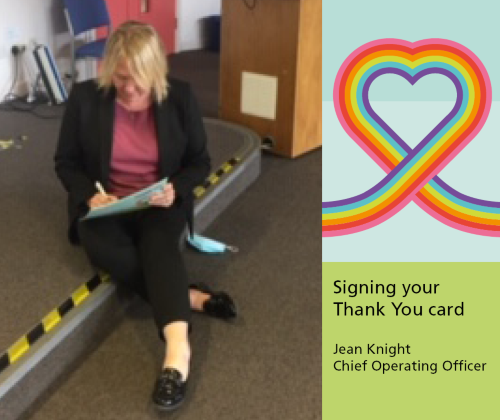Jean Knight Chief Operating Officer signing the staff thank you cards in the Willow Room at Berrywood Hospital, Northampton.