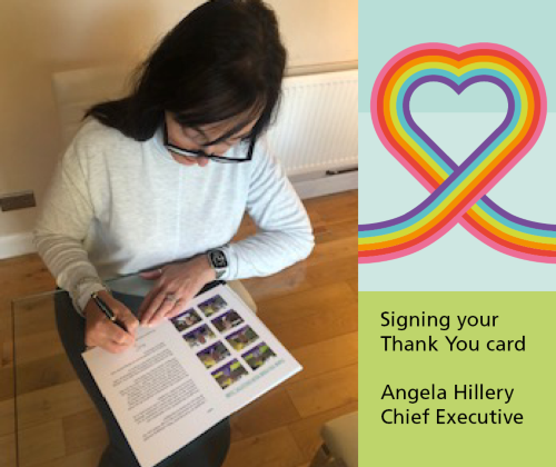 Angela Hillery Chief Executive signing the staff thank you cards at home