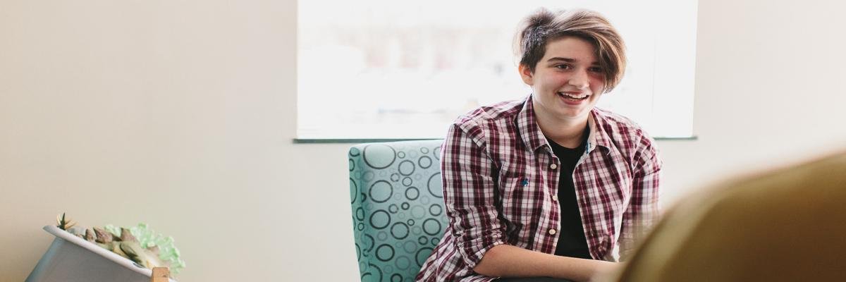 Male teen in medical office smiling